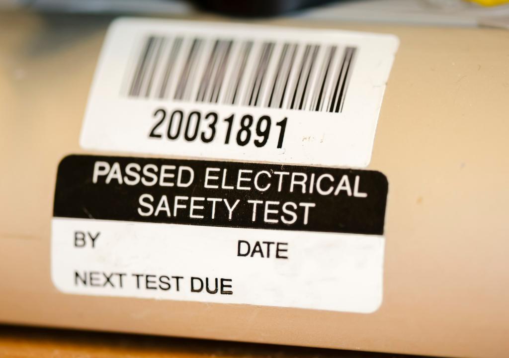 PAT testing sticker - photo by Stephen Barnes - Getty / Canva