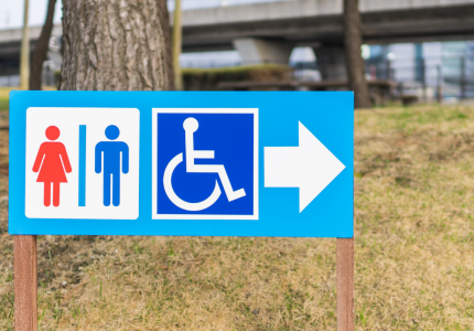 Disabled toilet sign - Photo by juice - Getty / Canva
